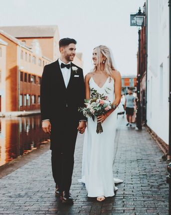 Intimate Gas Street church wedding with the bride in a slip wedding dress and the groom in a tuxedo