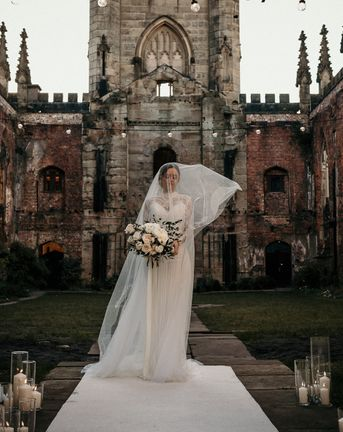Wedding Inspiration at St Luke's Bombed Out Church in Liverpool with white flowers, festoon lights and drapes.