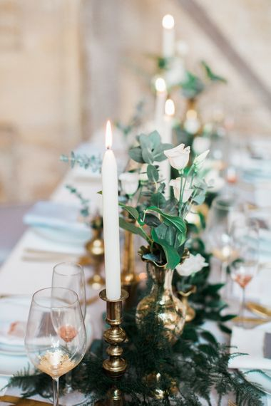 Elegant Place Setting With Gold Cutlery & Foliage Table Runner
