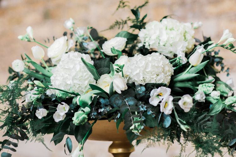 White Floral Display With Lots Of Foliage