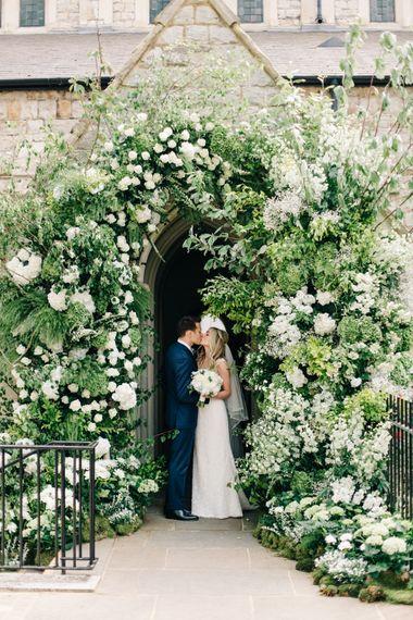 Bride & Groom Flower Arch Portrait