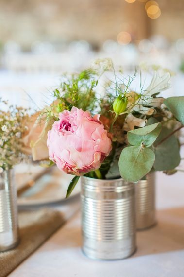 Pretty Blooms in Tin Cans