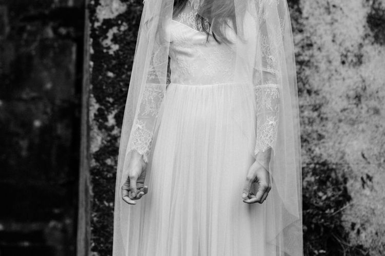 Bride with Lace Sleeved Dress