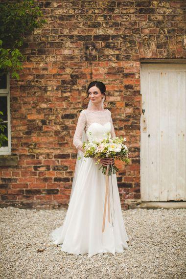 Bride in Caroline Castigliano Charm School Wedding Dress