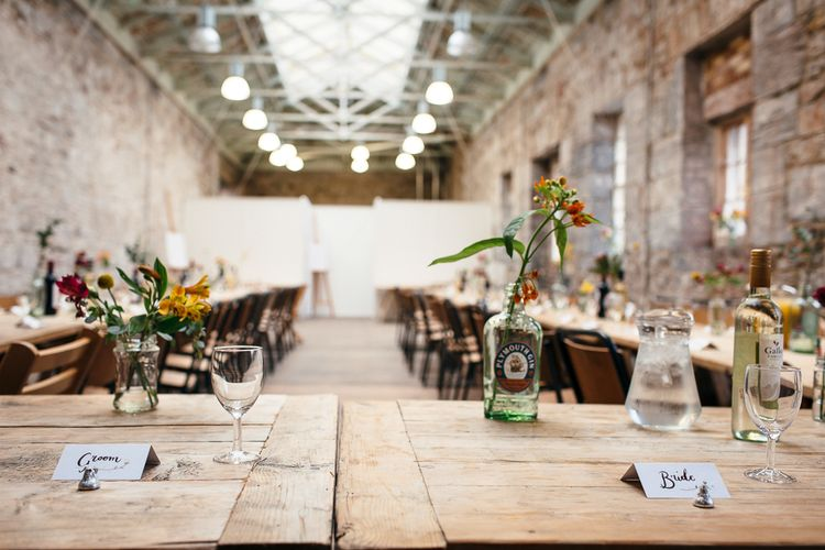 Trestle Table Scape     Relaxed Industrial Wedding at Ocean Studios, Plymouth   Freckle Photography