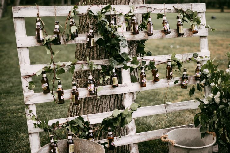 Brown Bottles Hanging on a Rustic Crate Wedding Decor