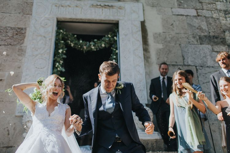 Confetti Moment with Bride in Luisa Beccaria Wedding Dress