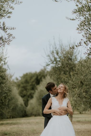 Couple Portrait with Bride in Luisa Beccaria Wedding Dress