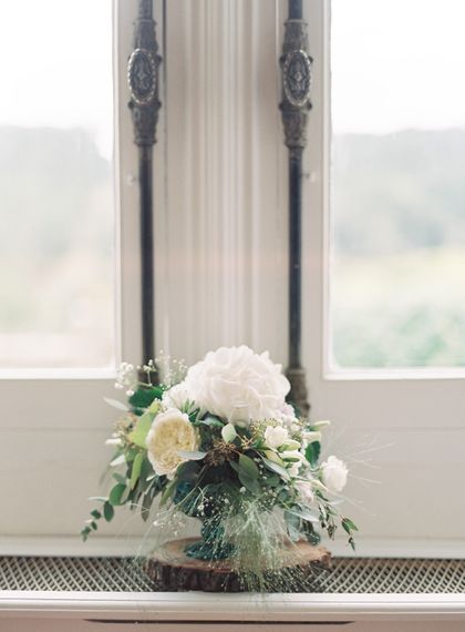 Elegant White Flower Arrangement | Fairytale Castle Wedding at Chateau de Lisse in France | Lilli Kad Photography