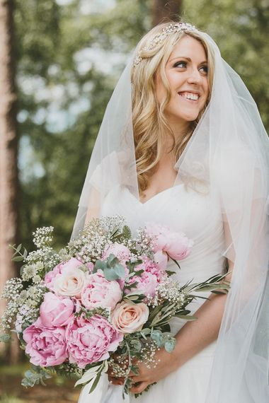 Bride in Suzanne Neville Bridal Gown with Pink Peony Wedding Bouquet