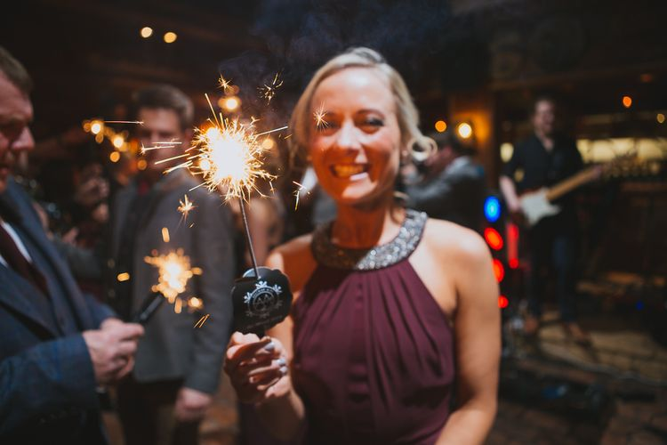 Bridesmaid in Burgundy Warehouse Dress with Sparkler
