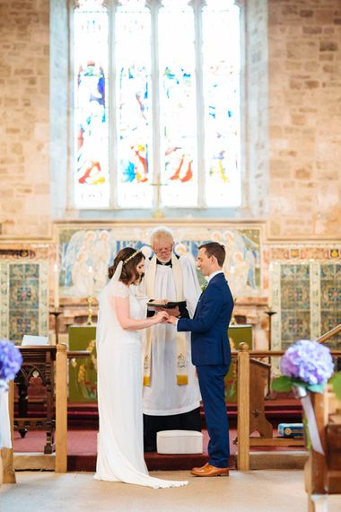 Church Wedding Ceremony   Bride in Belle and Bunny Bridal Separates   Groom in John Lewis Kin Navy Blue Suit   Laura Debourde Photography
