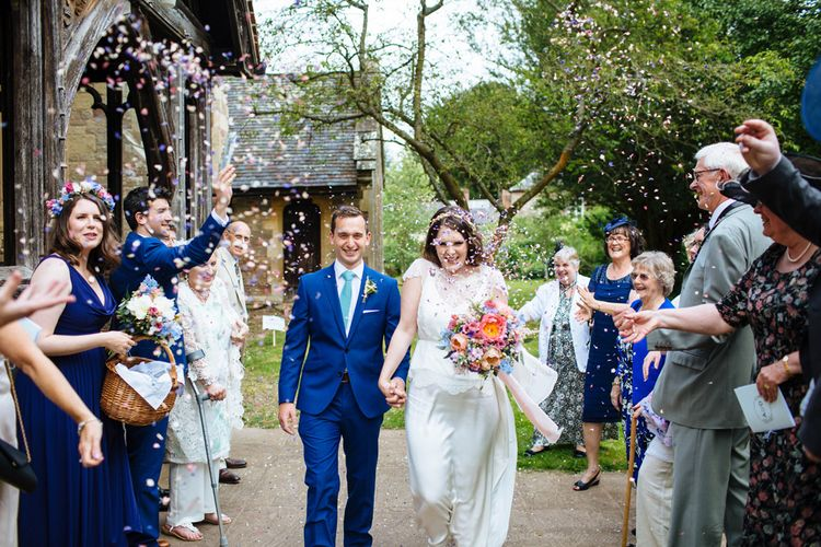 Confetti Moment   Church Wedding Ceremony   Bride in Belle and Bunny Bridal Separates   Groom in John Lewis Kin Navy Blue Suit   Laura Debourde Photography
