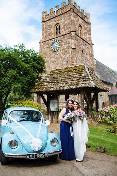 Church & Wedding Car   Bride in Belle and Bunny Bridal Separates   Bridesmaid in Navy Blue ASOS Dress   Laura Debourde Photography