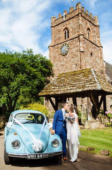 Church & Wedding Car   Bride in Belle and Bunny Bridal Separates   Groom in John Lewis Kin Navy Blue Suit   Laura Debourde Photography