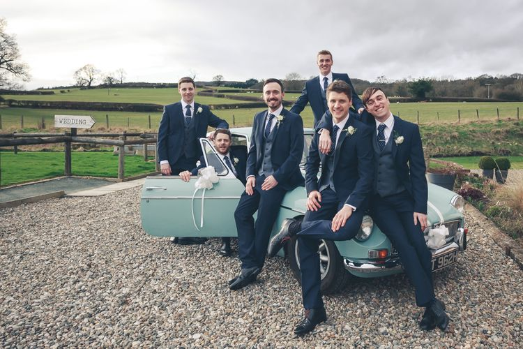 Groomsmen In Navy Suits With Waistcoats