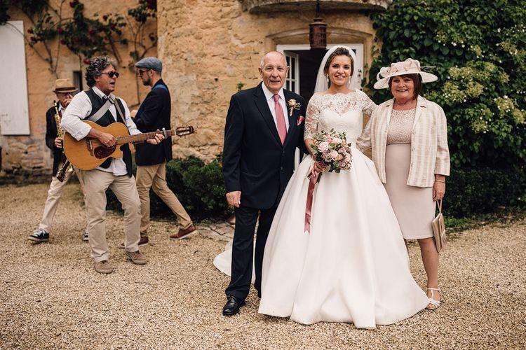 Elegant Pronovias Bride For A Destination Wedding At Chateau de Cazenac With Rustic Rose Floral Arrangements And Images From Samuel Docker