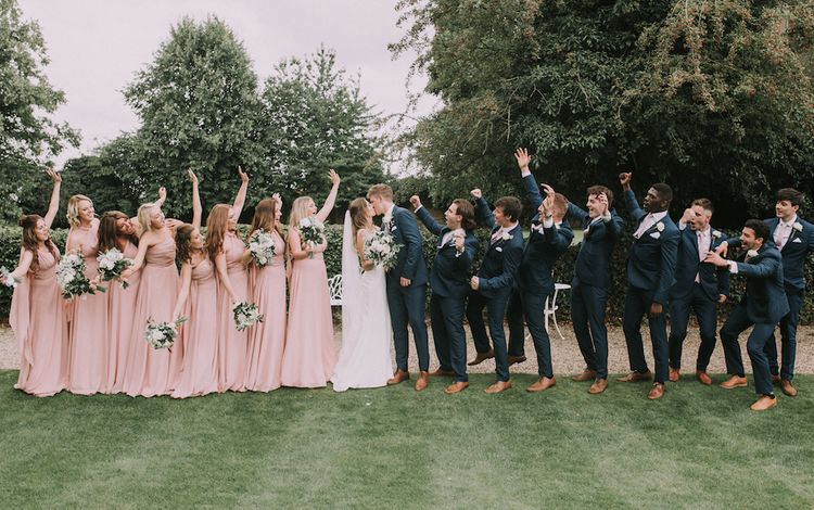 Stunning Ronald Joyce Bride For A Family Wedding At Leez Priory With Large Wedding Party & Bridesmaids In Pink With Images From Nataly J Photography