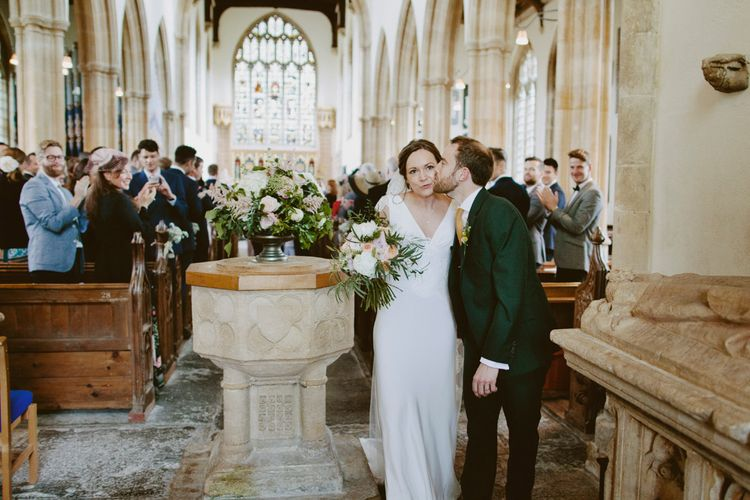 Bride in Rose & Delilah Gown | Groom in Donegal Green Wool Three Piece Suit from Beggars Run | David Jenkins Photography | Confetti & Silk Films