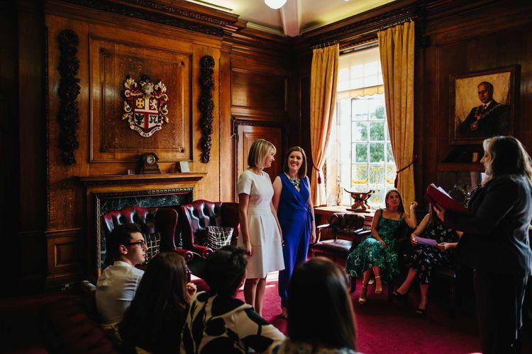 Two Brides in White Hugo Boss Dress & Cobalt Blue Diane Von Furstenberg Jumpsuit
