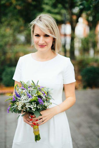 Bride in White Hugo Boss Dress