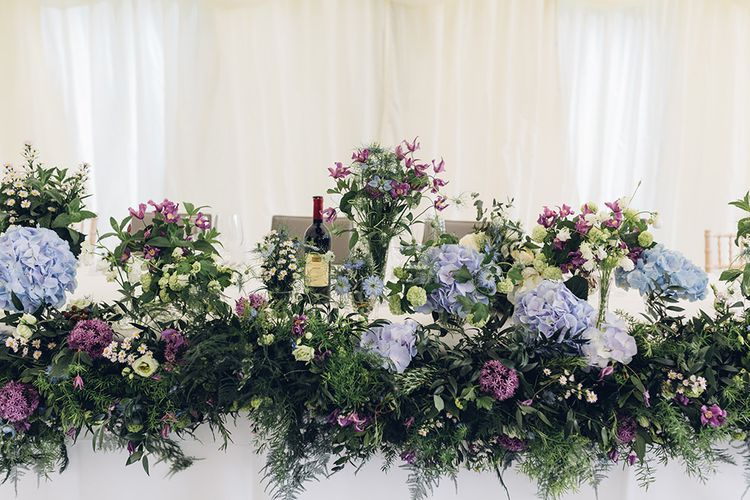 Top Table Floral Arrangements | Marquee Reception | Miss Gen Photography