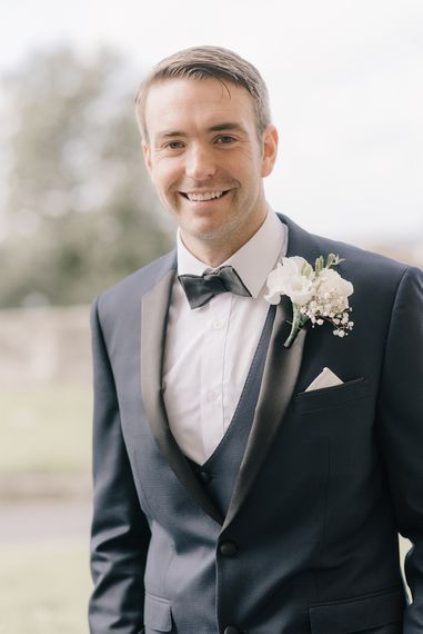 Groom in Three Piece Navy Tuxedo Suit | Elegant Black Tie Wedding with White Flowers at The Cleveland Tontine, North Yorkshire | Georgina Harrison Photography