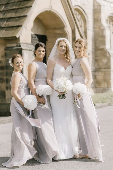 Bridal Party | Bridesmaids in Grey ASOS Dresses | Bride in Enzoani Juri Bridal Gown | Elegant Black Tie Wedding with White Flowers at The Cleveland Tontine, North Yorkshire | Georgina Harrison Photography