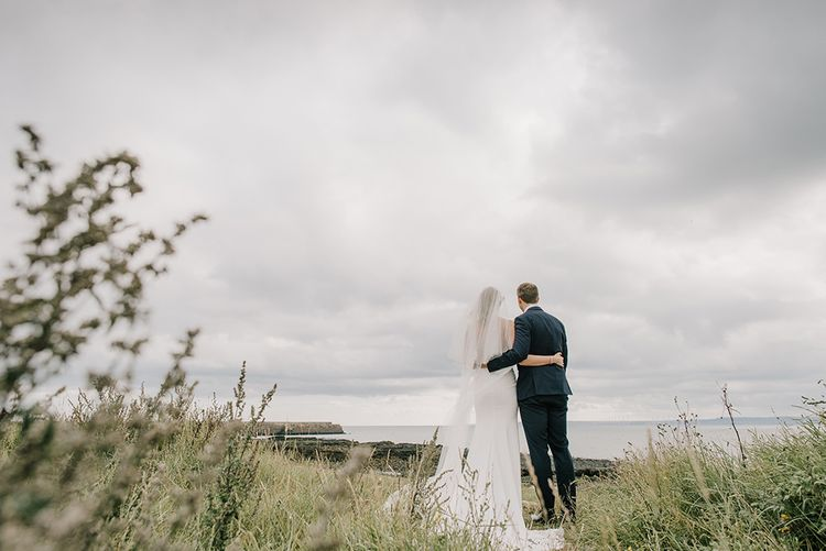 Bride in Enzoani Juri Bridal Gown | Groom in Black Tie | Elegant Black Tie Wedding with White Flowers at The Cleveland Tontine, North Yorkshire | Georgina Harrison Photography