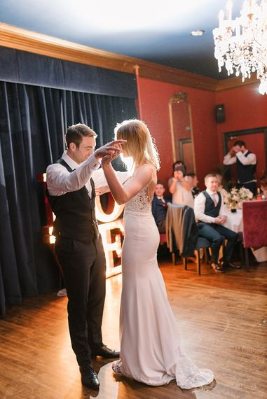 First Dance | Bride in Enzoani Juri Bridal Gown | Groom in Black Tie | Elegant Black Tie Wedding with White Flowers at The Cleveland Tontine, North Yorkshire | Georgina Harrison Photography