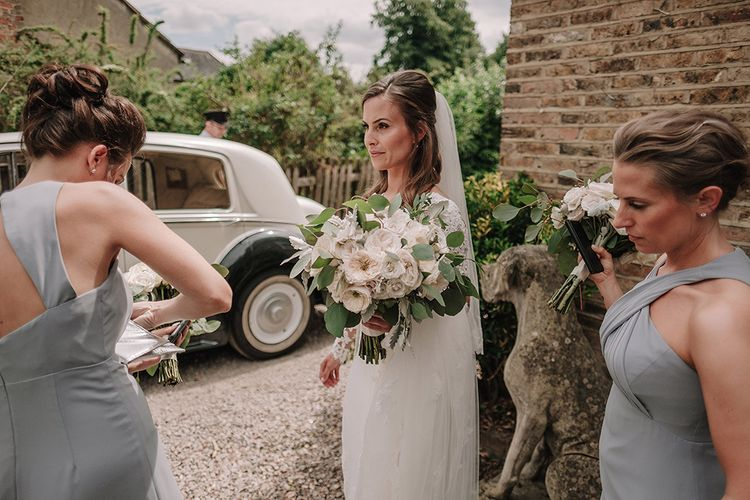 Bride in Lace Pronovias Wedding Dress | Bridesmaids in Grey Dessy Dresses | White and Silver English Country Garden At Home Marquee Wedding | Jason Mark Harris Photography