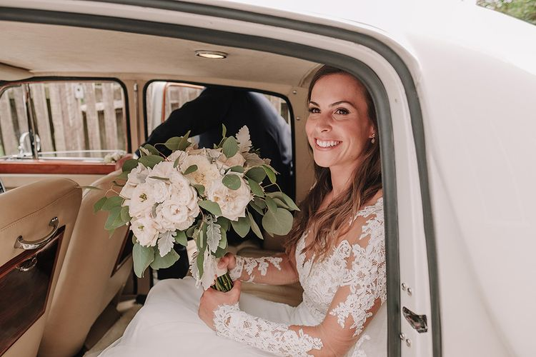 Bridal Entrance in Lace Pronovias Wedding Dress | White and Silver English Country Garden At Home Marquee Wedding | Jason Mark Harris Photography