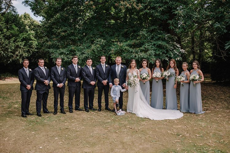 Wedding Party | Bride in Lace Pronovias Bridal Gown | Bridesmaids in Grey Dessy Dresses | Groom in Thom Sweeney Suit | White and Silver English Country Garden At Home Marquee Wedding | Jason Mark Harris Photography
