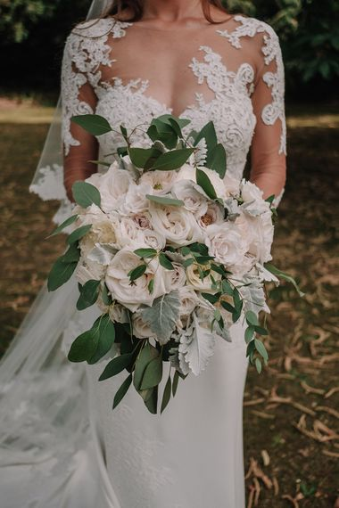 White Rose Wedding Bouquet | Bride in Lace Pronovias Bridal Gown | White and Silver English Country Garden At Home Marquee Wedding | Jason Mark Harris Photography