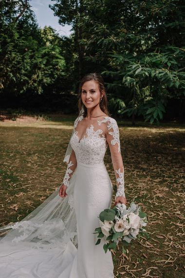 Bride in Lace Pronovias Bridal Gown | White and Silver English Country Garden At Home Marquee Wedding | Jason Mark Harris Photography
