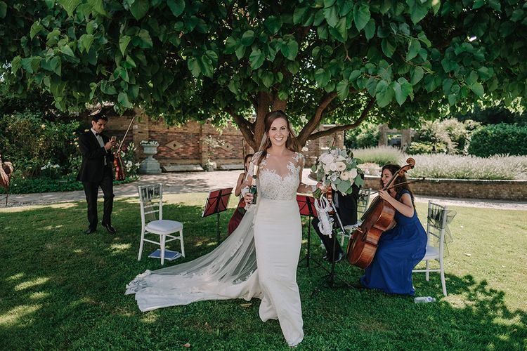 Bride in Lace Pronovias Wedding Dress | White and Silver English Country Garden At Home Marquee Wedding | Jason Mark Harris Photography
