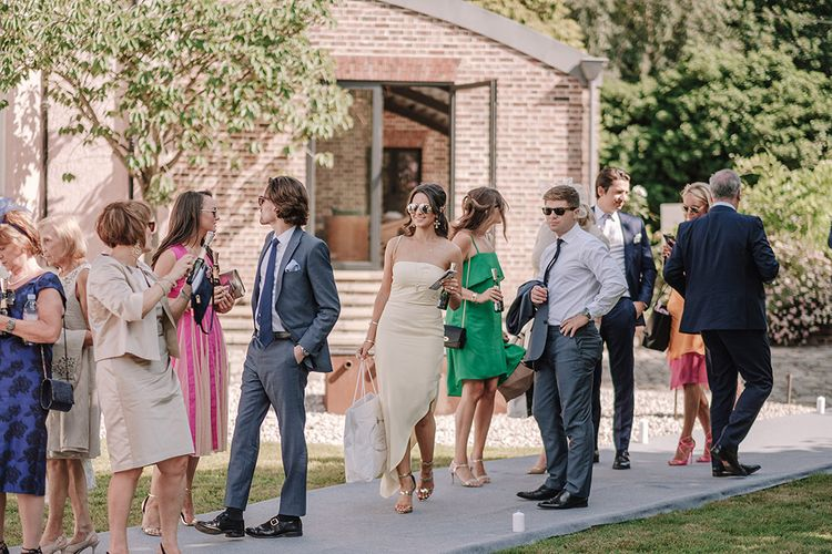 Wedding Guests | White and Silver English Country Garden At Home Marquee Wedding | Jason Mark Harris Photography