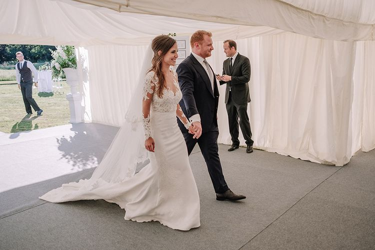 Bride in Lace Pronovias Bridal Gown | Groom in Thom Sweeney Suit | White and Silver English Country Garden At Home Marquee Wedding | Jason Mark Harris Photography