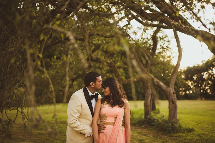Bride in Coral Sari For Wedding Reception At Poundon House
