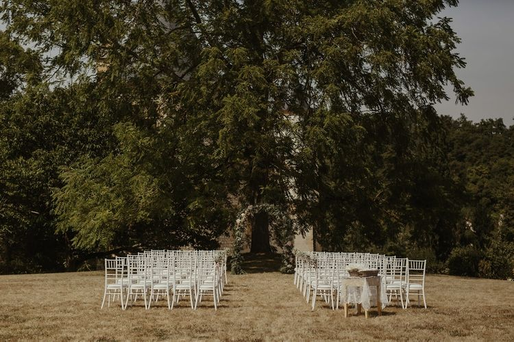 Outdoor Wedding Ceremony with Floral Arch | Destination Wedding at Château de Saint Martory in France Planned by Senses Events | Danelle Bohane Photography | Matthias Guerin Films