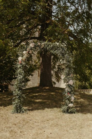 Floral Arch | Destination Wedding at Château de Saint Martory in France Planned by Senses Events | Danelle Bohane Photography | Matthias Guerin Films