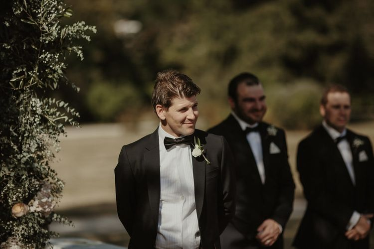 Groom in Paul Smith Black Tie Suit | Outdoor Destination Wedding at Château de Saint Martory in France Planned by Senses Events | Danelle Bohane Photography | Matthias Guerin Films