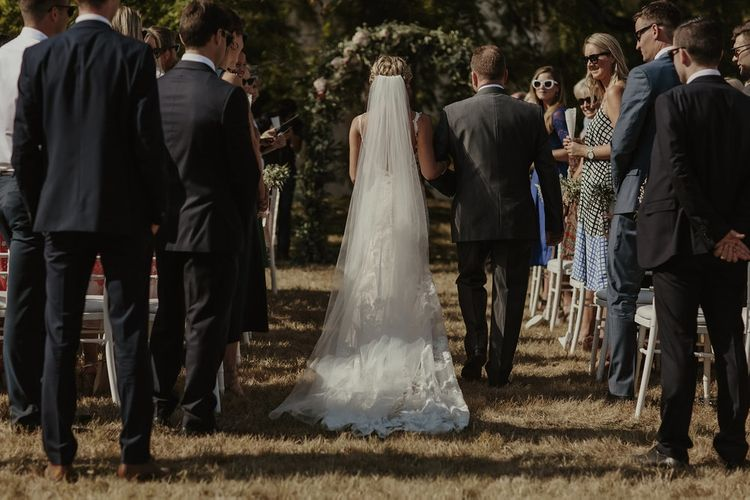 Bridal Entrance in Lace Stella York Gown | Outdoor Destination Wedding at Château de Saint Martory in France Planned by Senses Events | Danelle Bohane Photography | Matthias Guerin Films