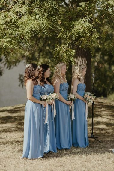 Bridesmaids in Blue Dessy Dresses | Outdoor Destination Wedding at Château de Saint Martory in France Planned by Senses Events | Danelle Bohane Photography | Matthias Guerin Films