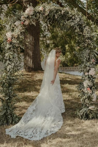 Floral Arch | Bride in Lace Stella York Dress | Outdoor Destination Wedding at Château de Saint Martory in France Planned by Senses Events | Danelle Bohane Photography | Matthias Guerin Films