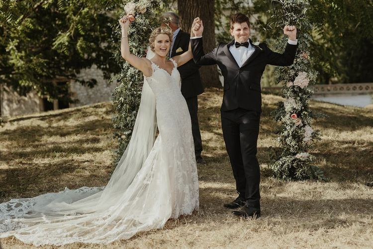 Wedding Ceremony | Floral Arch | Bride in Lace Stella York Dress | Groom in Black Tie | Outdoor Destination Wedding at Château de Saint Martory in France Planned by Senses Events | Danelle Bohane Photography | Matthias Guerin Films