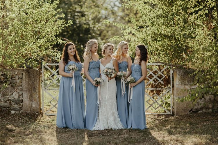 Bride in Stella York Gown | Bridesmaids in Blue Dessy Dresses | Outdoor Destination Wedding at Château de Saint Martory in France Planned by Senses Events | Danelle Bohane Photography | Matthias Guerin Films