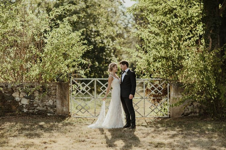 Bride in Lace Stella York Dress | Groom in Black Tie | Outdoor Destination Wedding at Château de Saint Martory in France Planned by Senses Events | Danelle Bohane Photography | Matthias Guerin Films