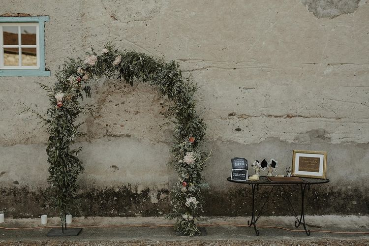 Photo Booth with Floral Arch | Outdoor Destination Wedding at Château de Saint Martory in France Planned by Senses Events | Danelle Bohane Photography | Matthias Guerin Films