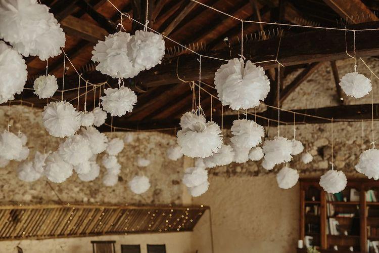Hanging Pom Poms | Outdoor Destination Wedding at Château de Saint Martory in France Planned by Senses Events | Danelle Bohane Photography | Matthias Guerin Films